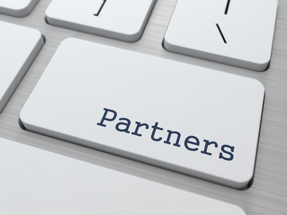 Partnership Concept. Button on Modern Computer Keyboard with Word Partners on It..jpeg
